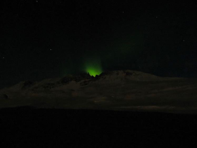 Northern lights behind the mountain range near Akureyri in northern Iceland.