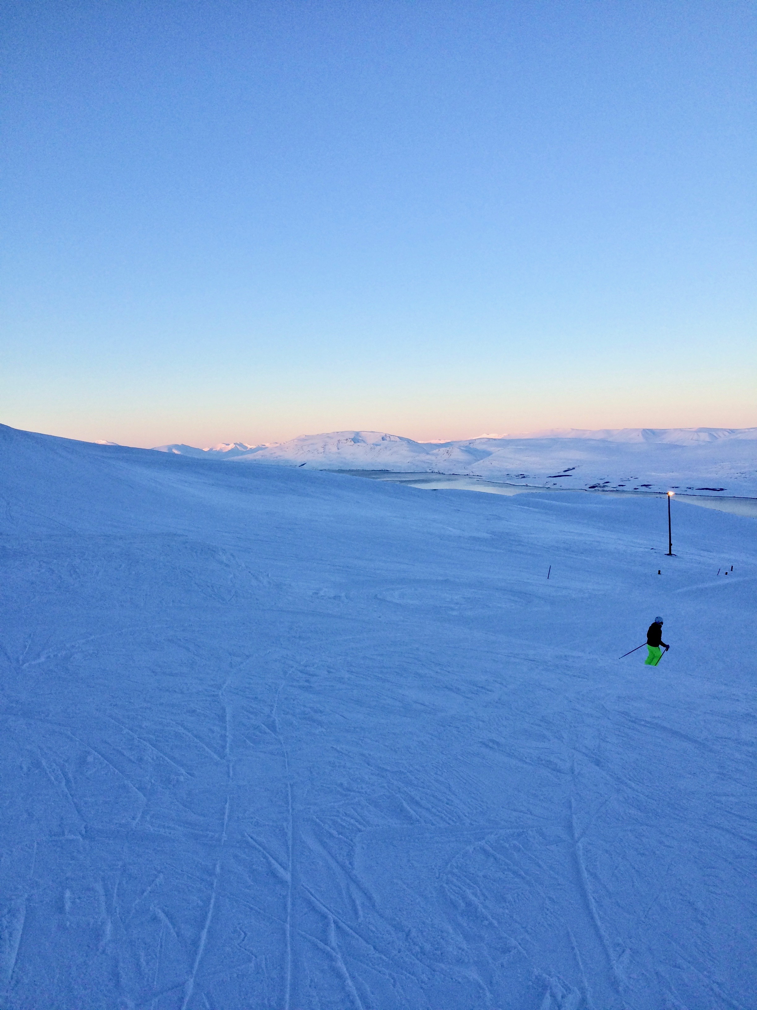 Dusky hues in the distance on a piste at Hlíðarfjall Akureyri ski resort