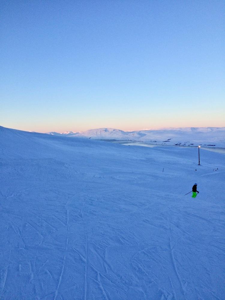 Dusky hues in the distance on a piste at Hlíðarfjall Akureyri ski resort