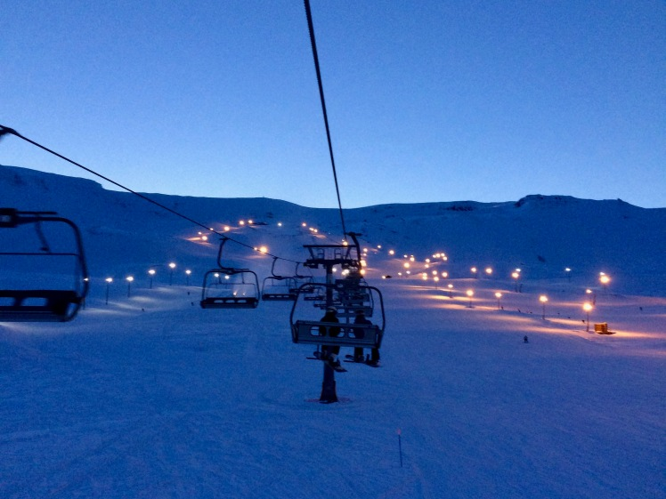 Dusk on the chair lift at Hlíðarfjall ski resort