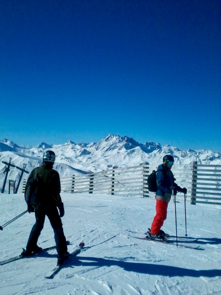 Skiers heading out on the Smuggler's Run from Ischgl to Samnaun in Switzerland