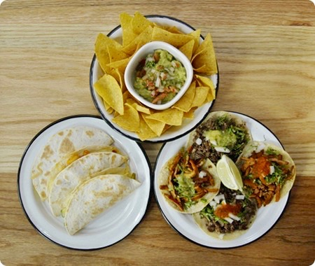 A table of tacos, tostadas and chips at La Neta Mexican restaurant
