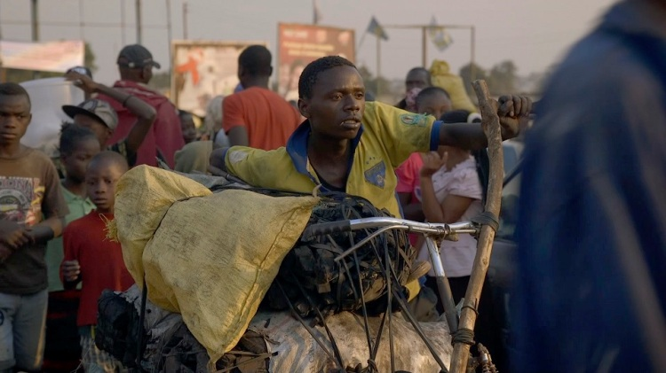 Kabwita Kasongo in Kolwezi with the remainder of his bags of charcoal to sell