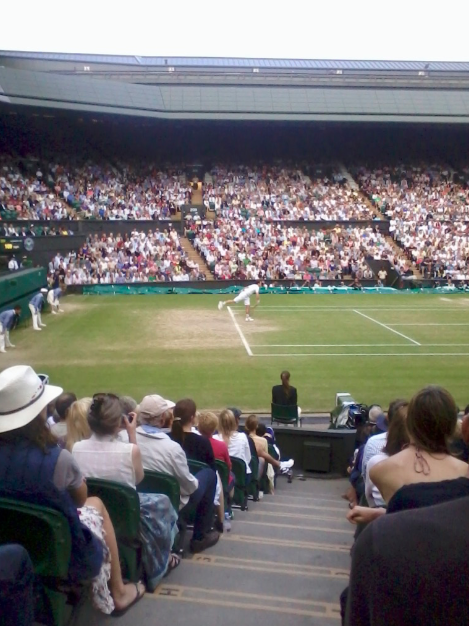 Andy Murray serves during the Semi Final of the 2013 Wimbledon Championships
