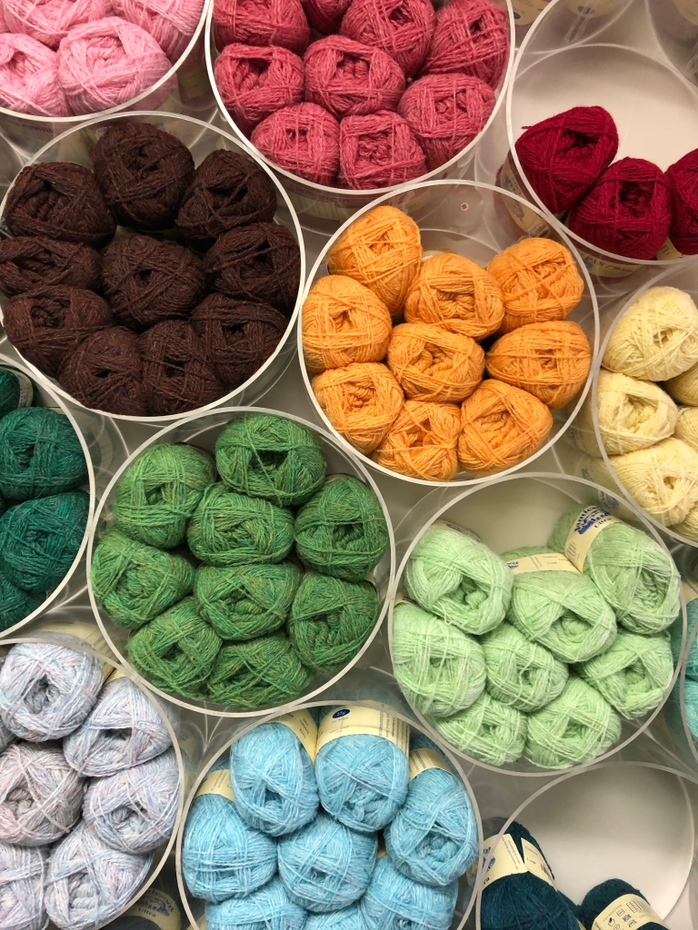 Spools of Jamieson's colourful wools