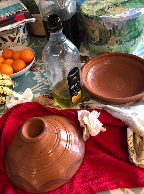 Rubbing olive oil into the tagine pot