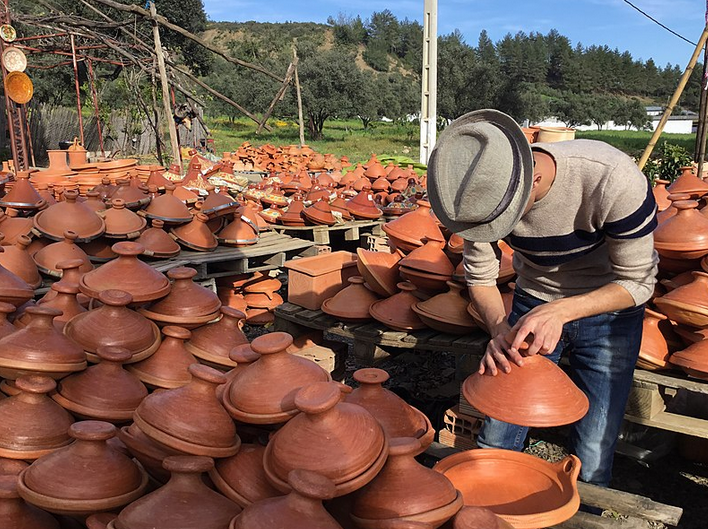 Stacks of clay tagine pots on display in Morocco