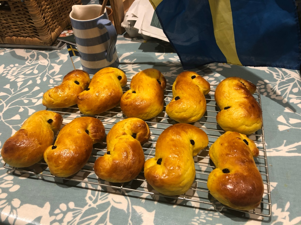 Ten freshly baked Lussebullar buns