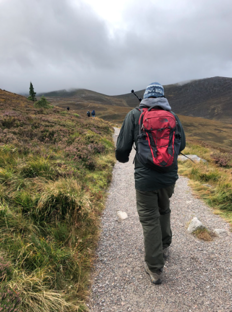 Heads bowed against crosswinds as we started our Cairngorm Plateau walk