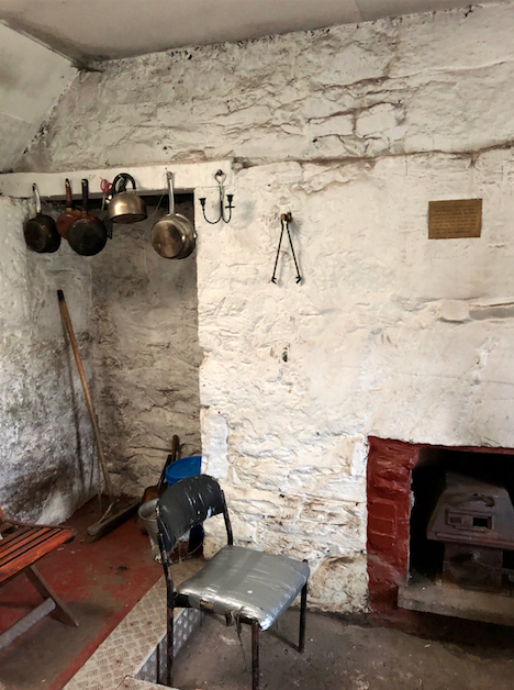 Pots and pans and fireplace inside the Ryvoan Pass bothy