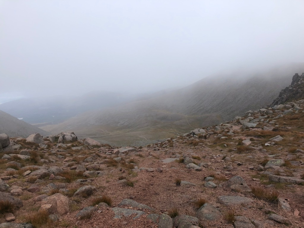 Near the mountain's edge, amidst a Mars-like rocky surface