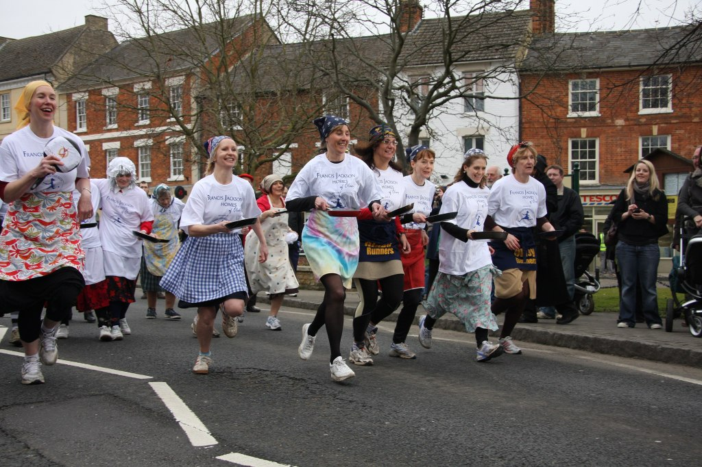 A pancake race in the town of Olney in Buckinghamshire