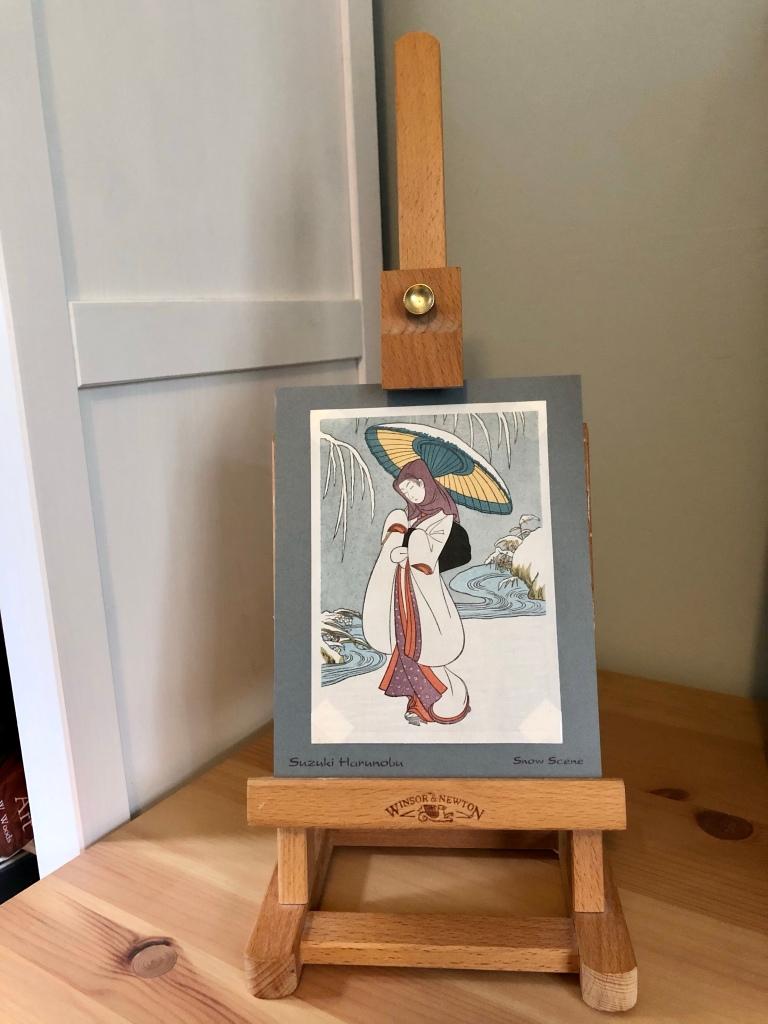 My Heron Maiden woodcut print on an easel
