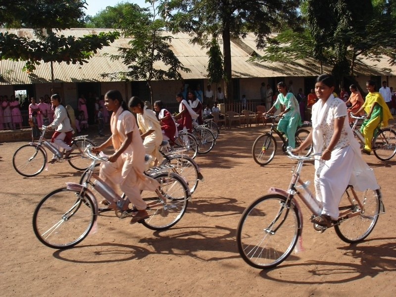 Girls cycling in rural india