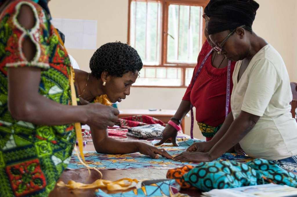 Women looking over fabric