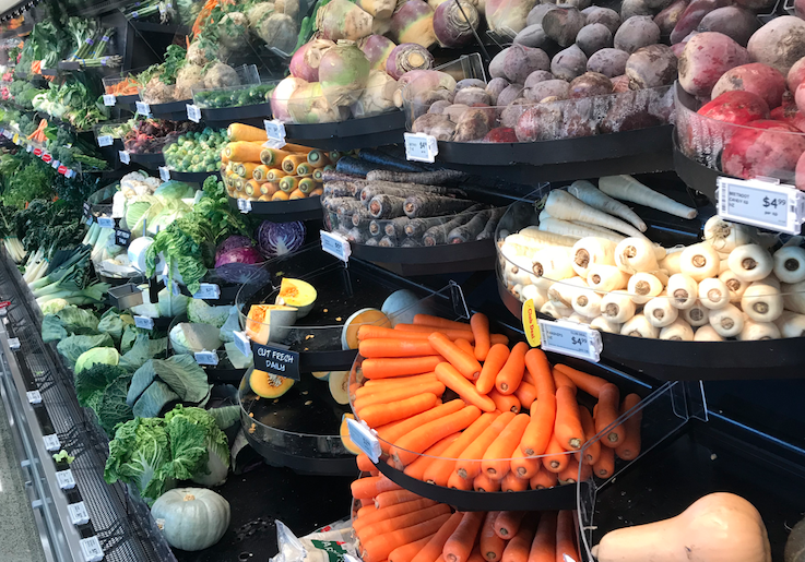 Unpackaged fresh fruit and vegetables in a supermarket